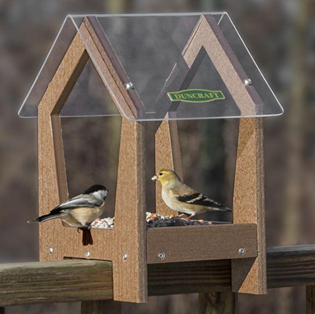 bird feeder attached to the deck railing