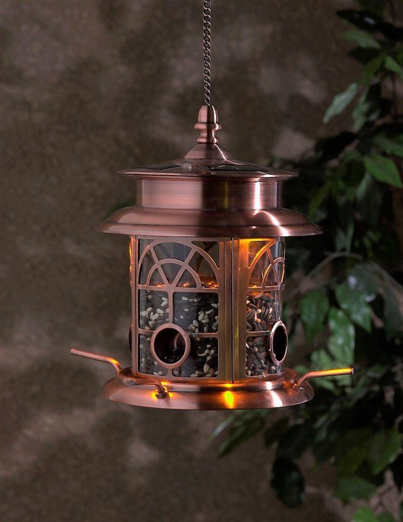 Decorative copper bird feeder with solar lights