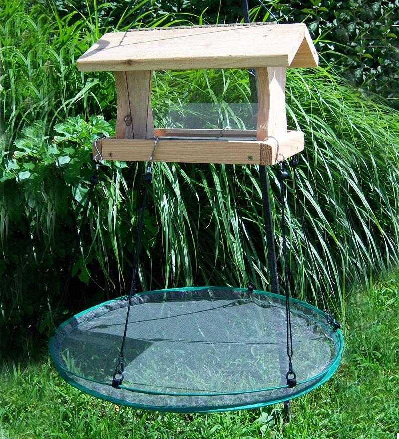 Wood bird feeder with seed catching platform feeder underneath